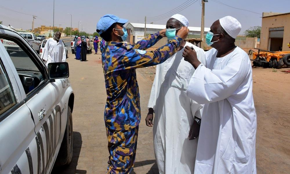 Bangladeshi UN peacekeepers provide masks and hand sanitizers to people in El Fasher, North Darfur.