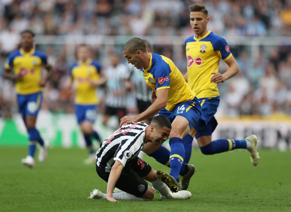 Newcastle United's Miguel Almiron is fouled by Southampton's Oriol Romeu.