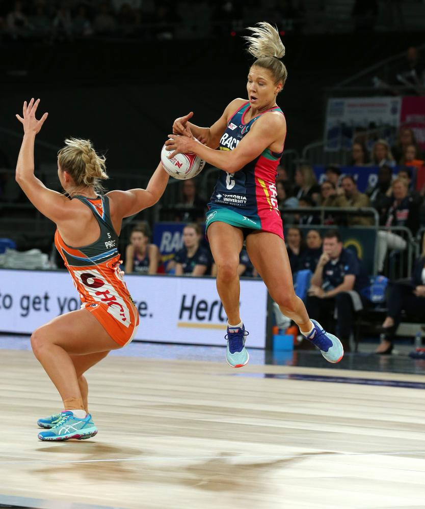 Jaime-Lee Price of the Giants and Kate Maloney of the Vixens