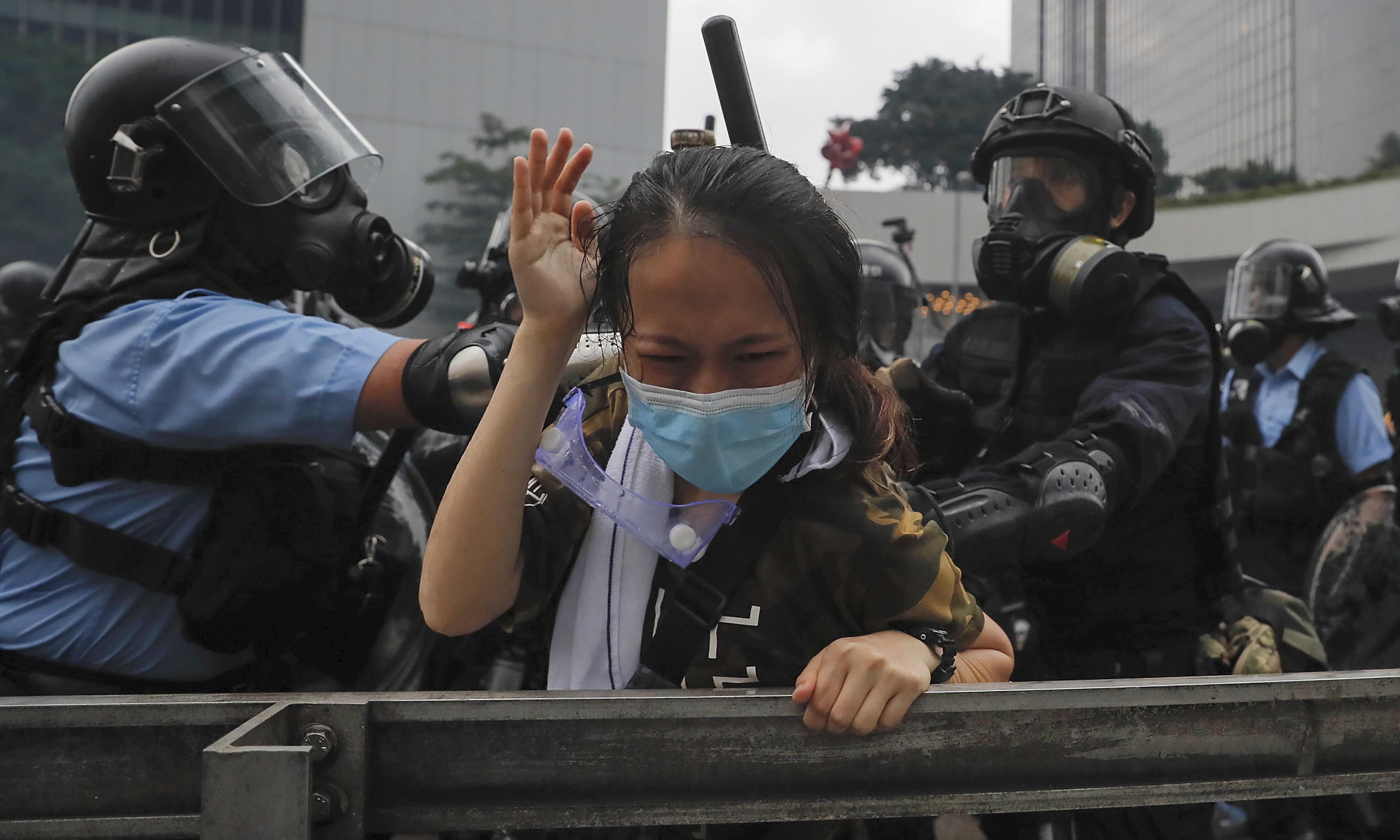 Police use rubber bullets as Hong Kong protesters vow 'no retreat'