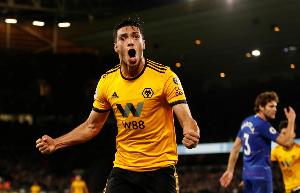 Raul Jimenez celebrates scoring the equaliser.