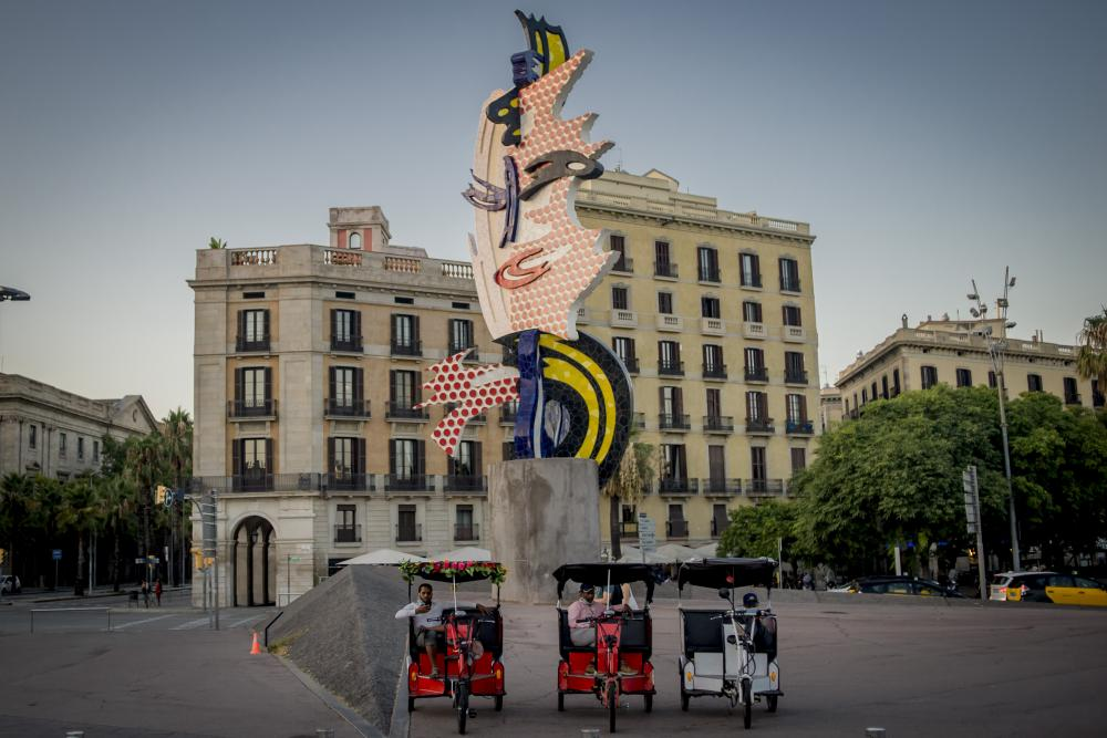 Rickshaw drivers wait for customers in Barcelona, Spain, on 31 July 2020.