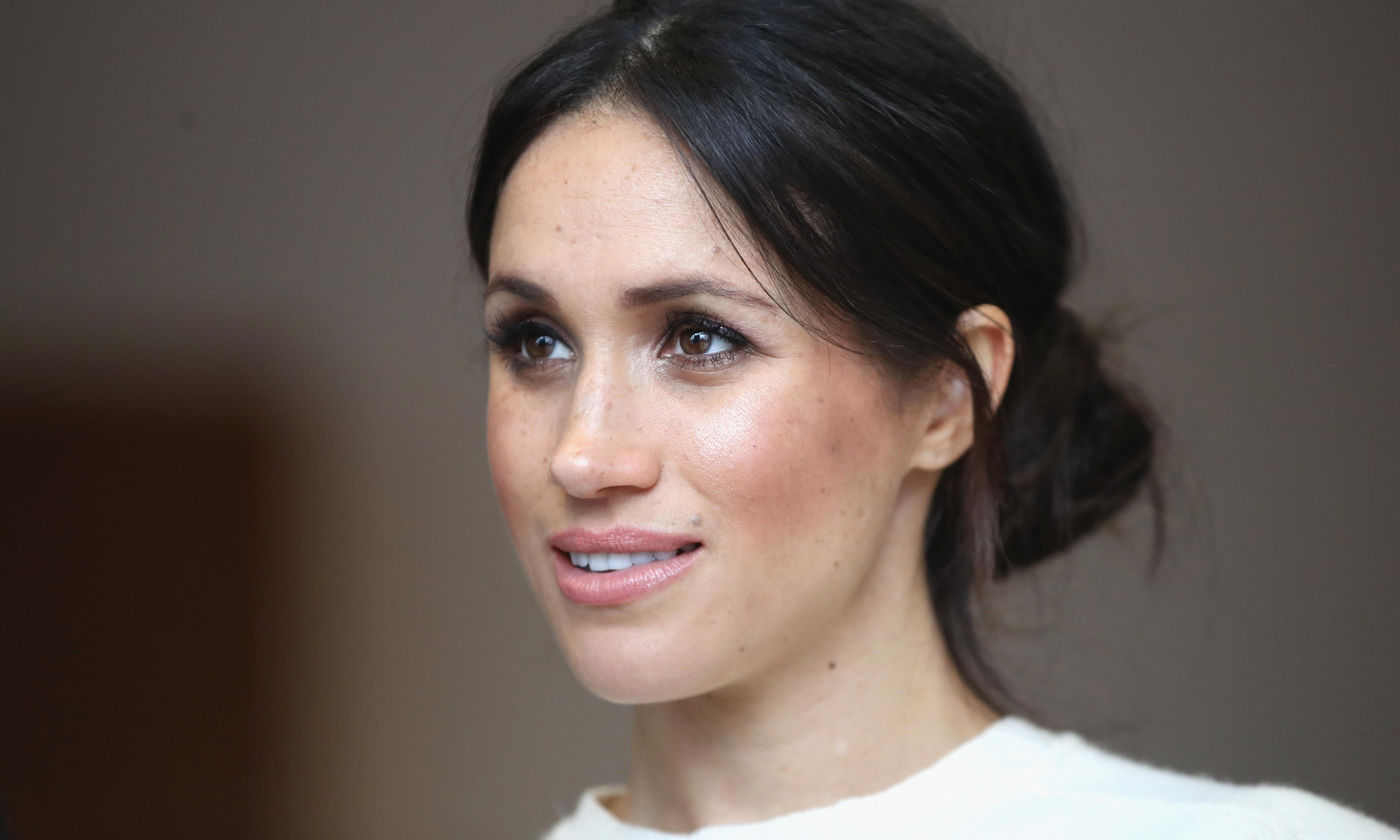Hair to the throne: Meghan's messy bun is perfect for a modern princess