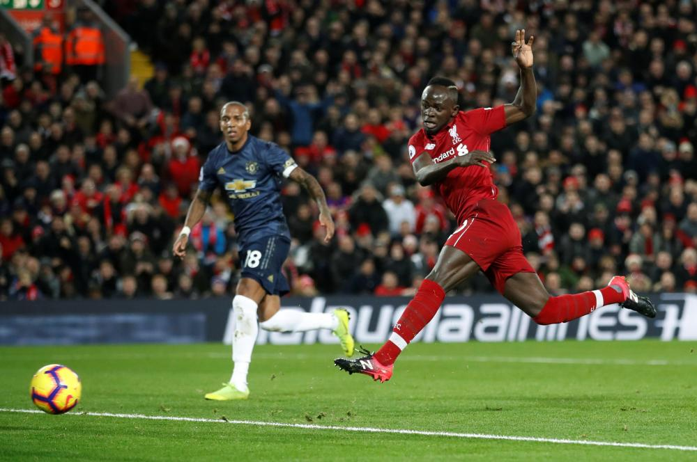 Liverpool's Sadio Mane scores their first goal