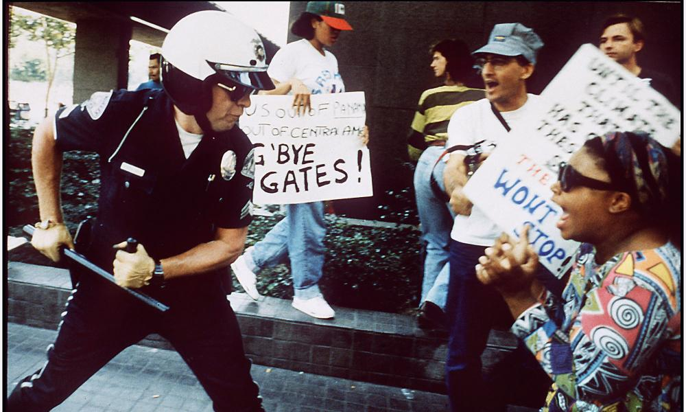 A police officer attacks protesters during the LA disturbances, 29 April 1992.