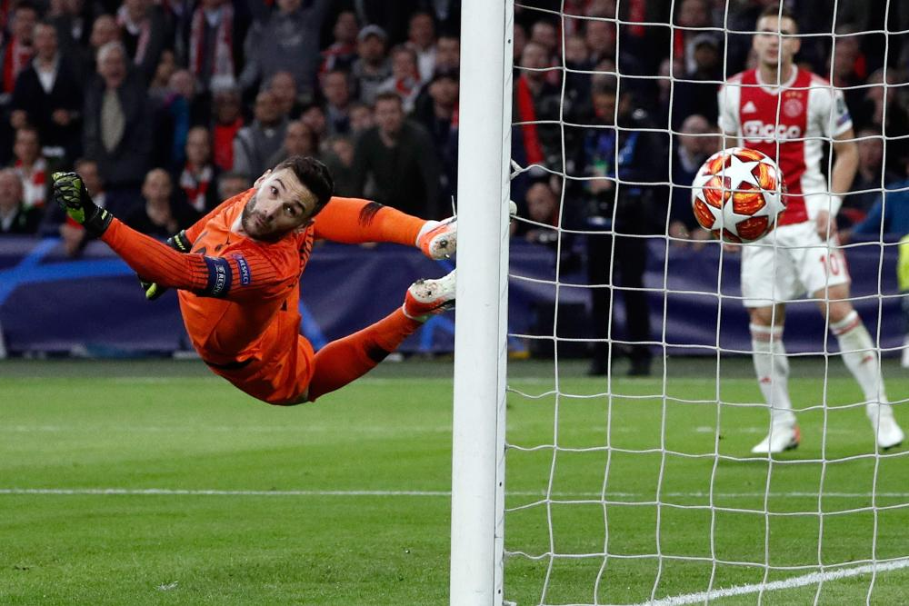 Lloris watches as the ball flies by.