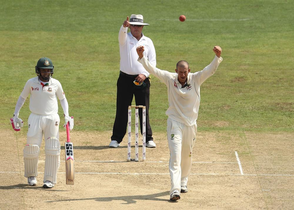 Ashton Agar celebrates the wicket of Shakib Al Hasan.