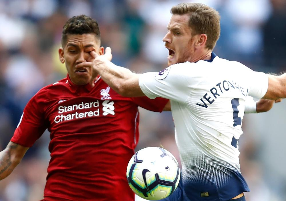 September 15: Jan Vertonghen of Tottenham Hotspur pokes Roberto Firmino of Liverpool in the eye.