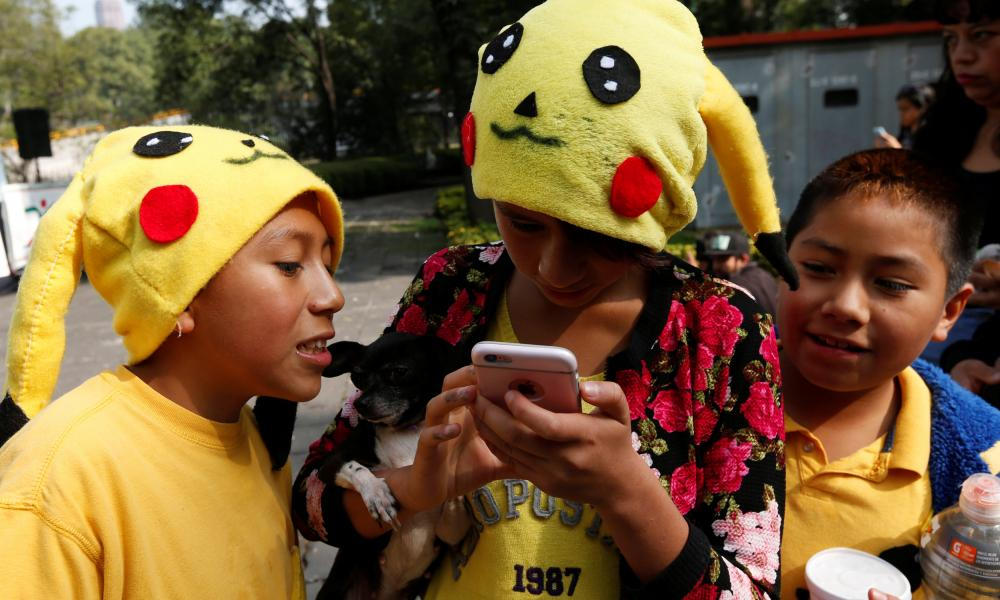 Children dressed as Pikachu play Pokemon Go in Mexico City on 21 August 2016.