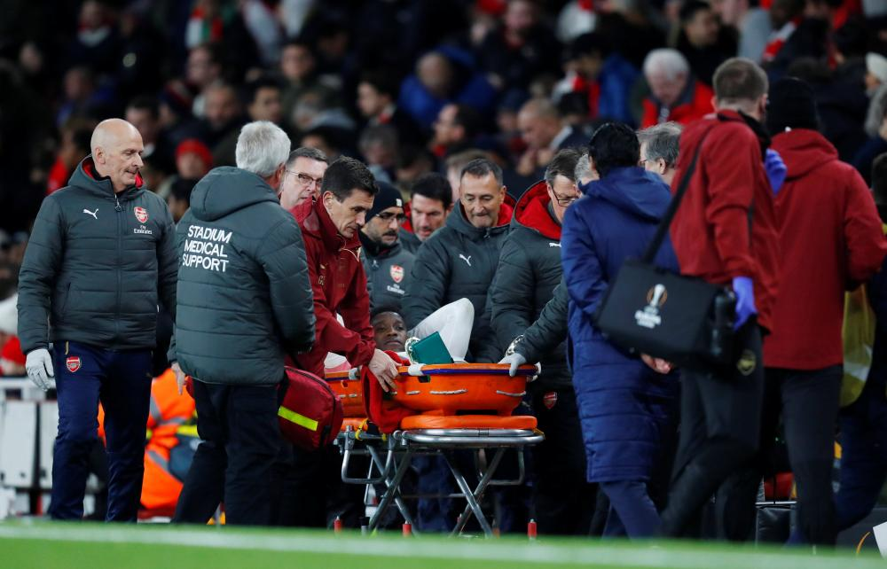 Welbeck leaves the pitch on a stretcher.