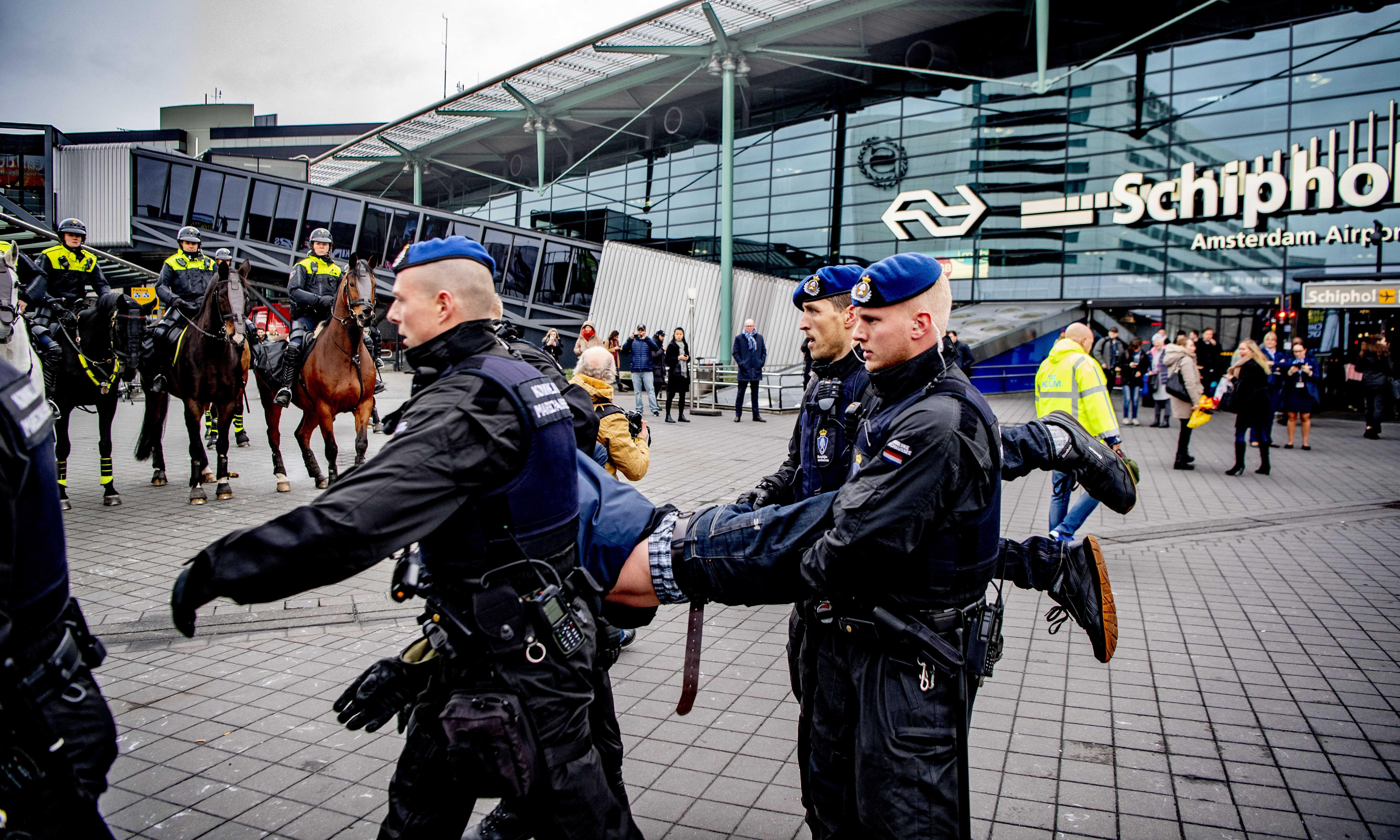 Military police remove climate protesters from Schiphol airport