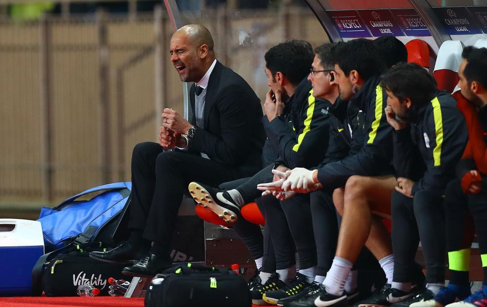 Manchester City manager Pep Guardiola shouts in anger and stomps his feet after the third Monaco goal.