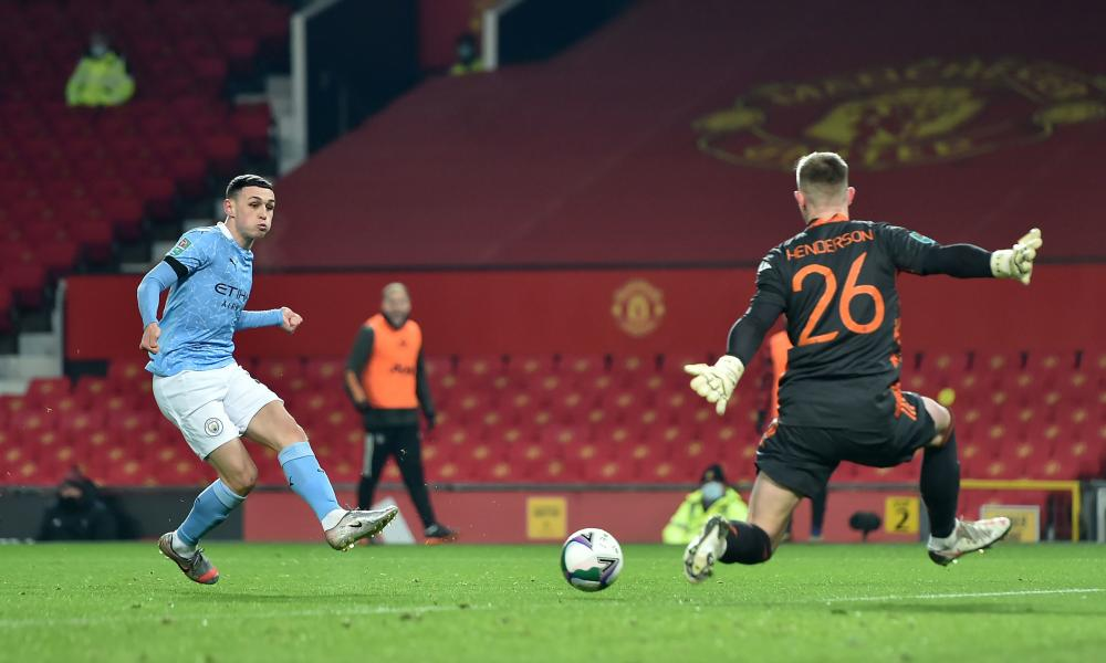 Manchester City's Phil Foden puts the ball into the net but he is thwarted by the linesman's flag, which is raised for offside.