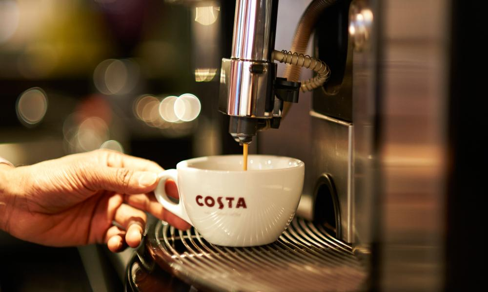 Costa Coffee barrista prepares a drink
