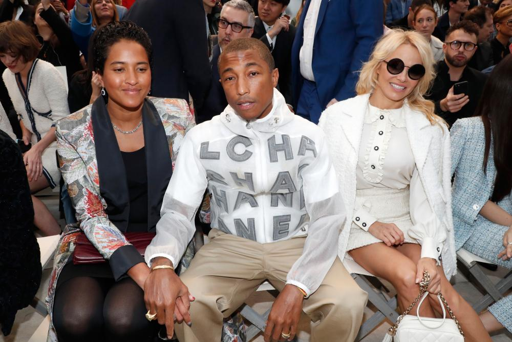 Pharrell Williams with his wife, Helen Lasichanh, left, and Pamela Anderson on the front row.