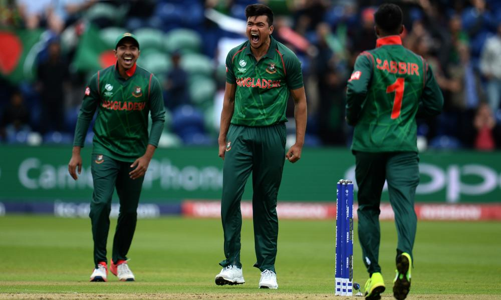 Taskin Ahmed of Bangladesh, centre, celebrates the wicket of Luke Ronchi.