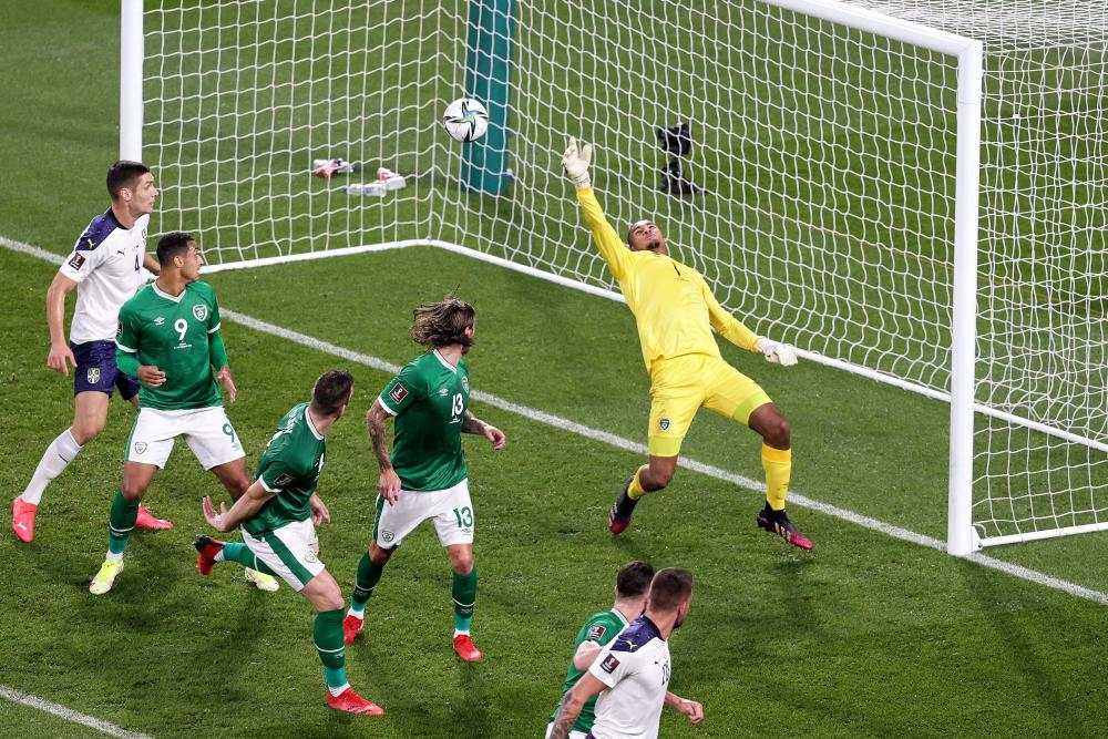 Ireland goalkeeper Gavin Bazunu concedes a goal to Sergej Milinkovic-Savic of Serbia.