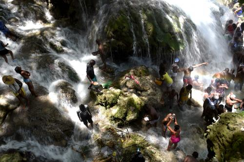 Pilgrims at Saut D'Eau, 40 miles north of Port-au-Prince. The site is revered in both Christianity and Vodou for its association with Our Lady of Mount Carmel and her Vodou equivalent, Ezili Dantor