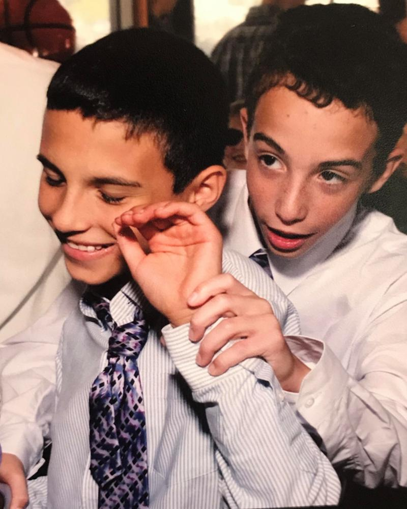 Scott, left, and Joshua Needelman, right, at their b'nai mitzvah.