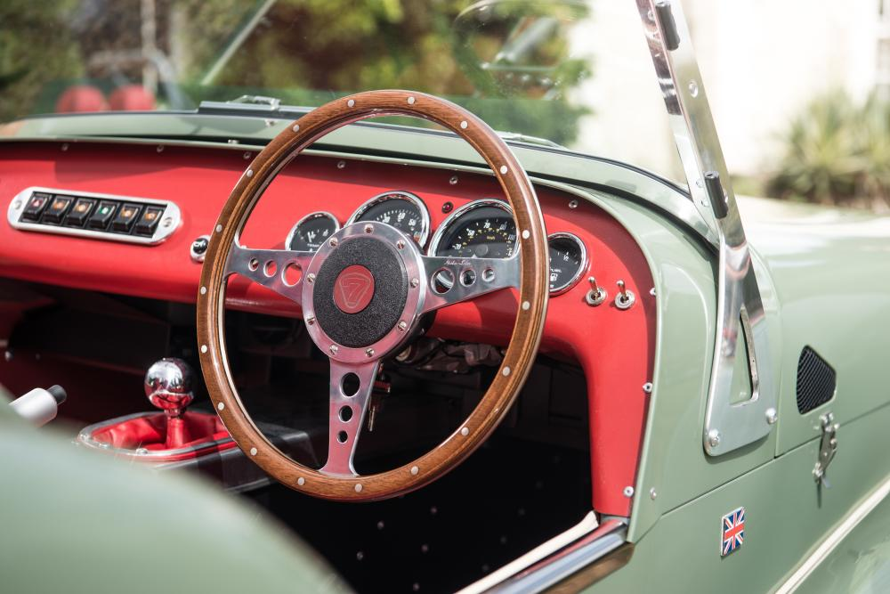 Back to the future: the gloriously basic interior, with flick switches, wooden steering wheel and aluminium gear stick