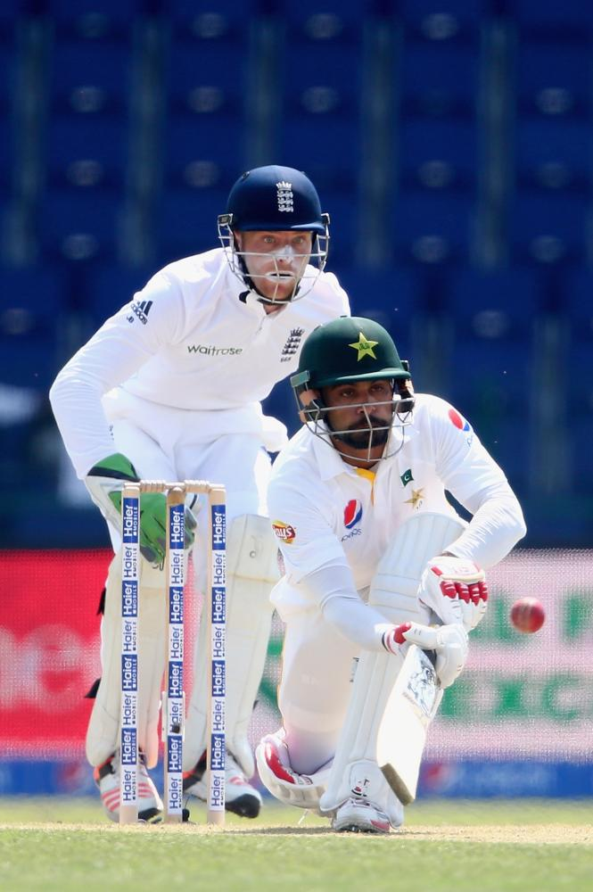 Mohammad Hafeez flicks the ball away as wicket-keeper Jos Buttler looks on.