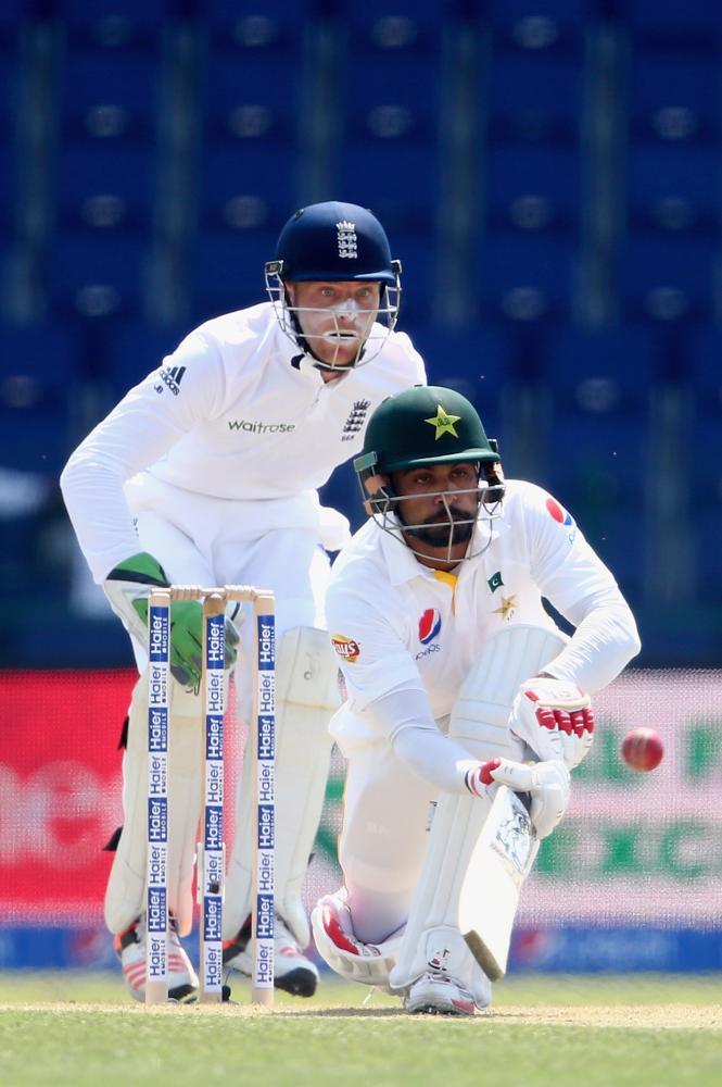 Mohammad Hafeez flicks the ball away as wicket-keeper Jos Buttler looks on.