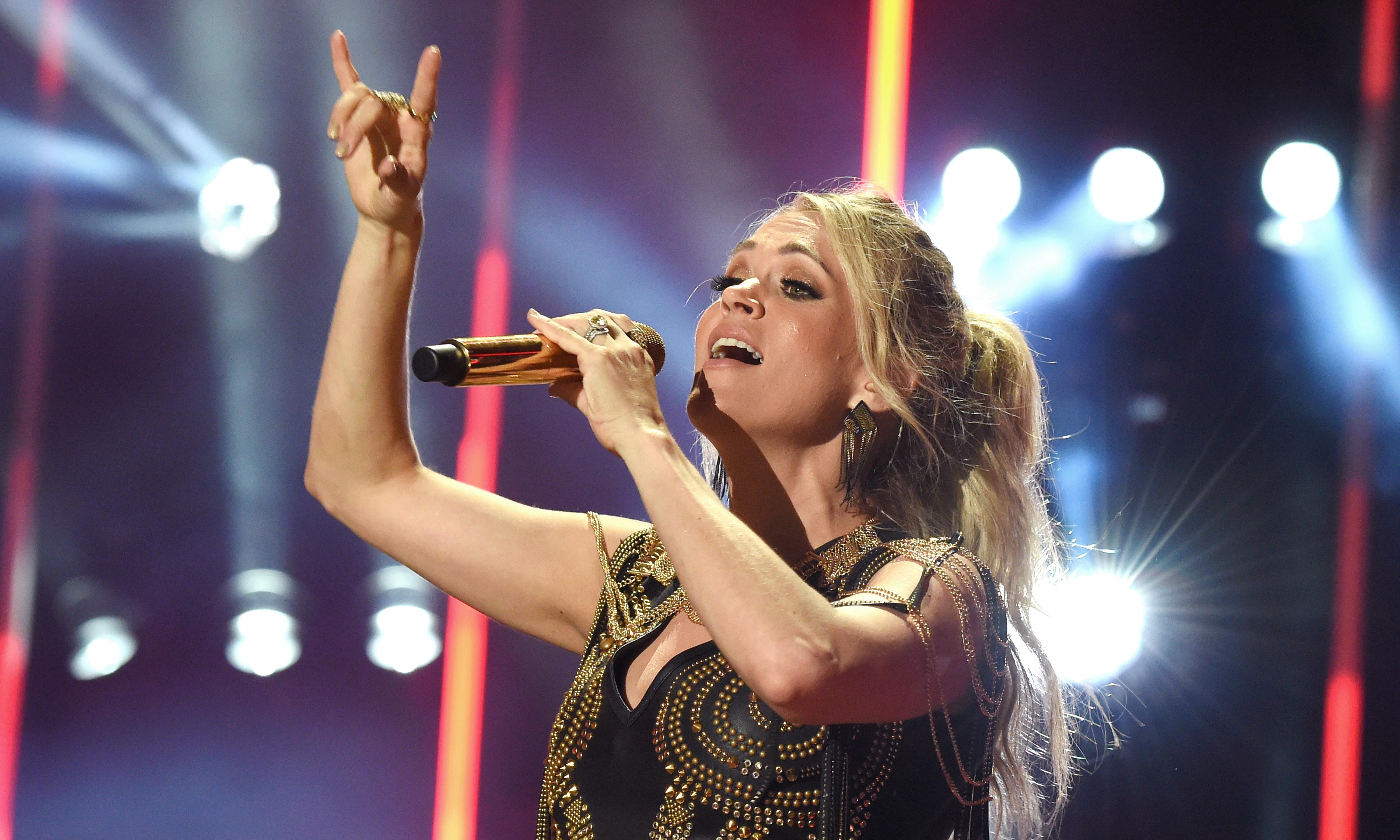 Carrie Underwood: 'I'd put on a happy face, then go home and fall apart'