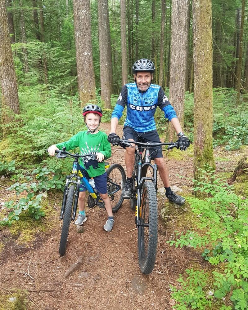 Jim Moore biking with his grandson Peter
