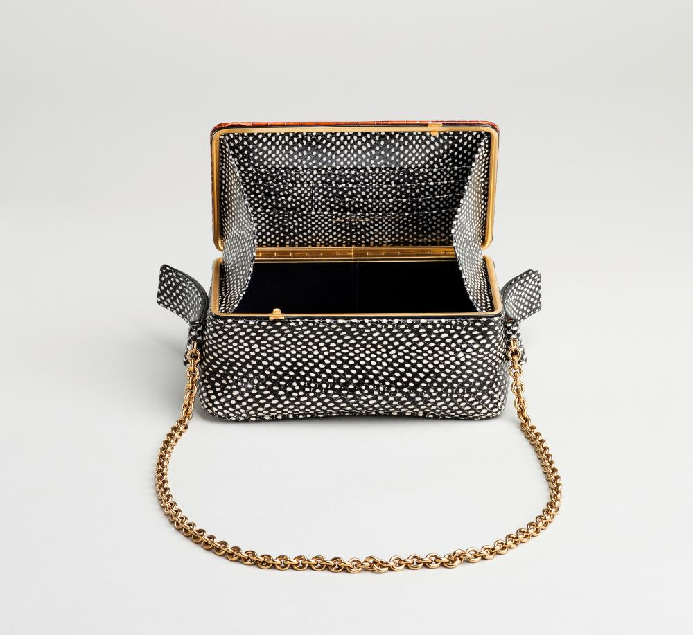 One of Lutz Morris's frame bags in faux crocodile and snakeskin.
