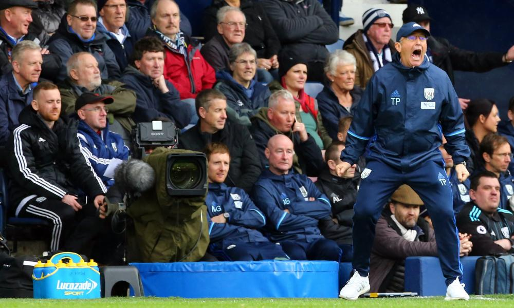 West Brom's boss Tony Pulis offers encouragement to his players.