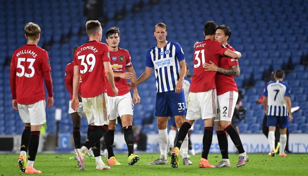 Manchester United's Nemanja Matic embraces Victor Lindelof at the final whistle.