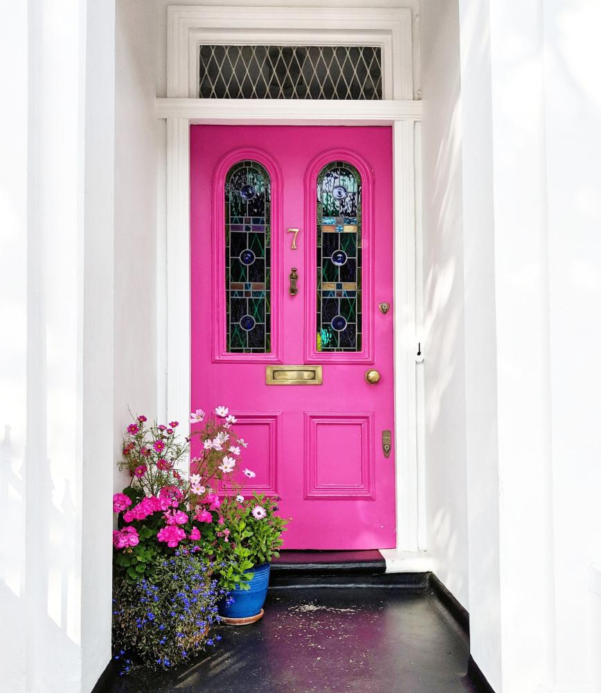 Think pink: a nice bright front door with flowers.