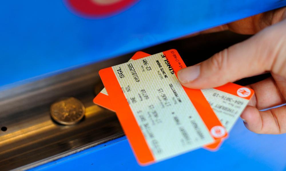 Man buying rail tickets