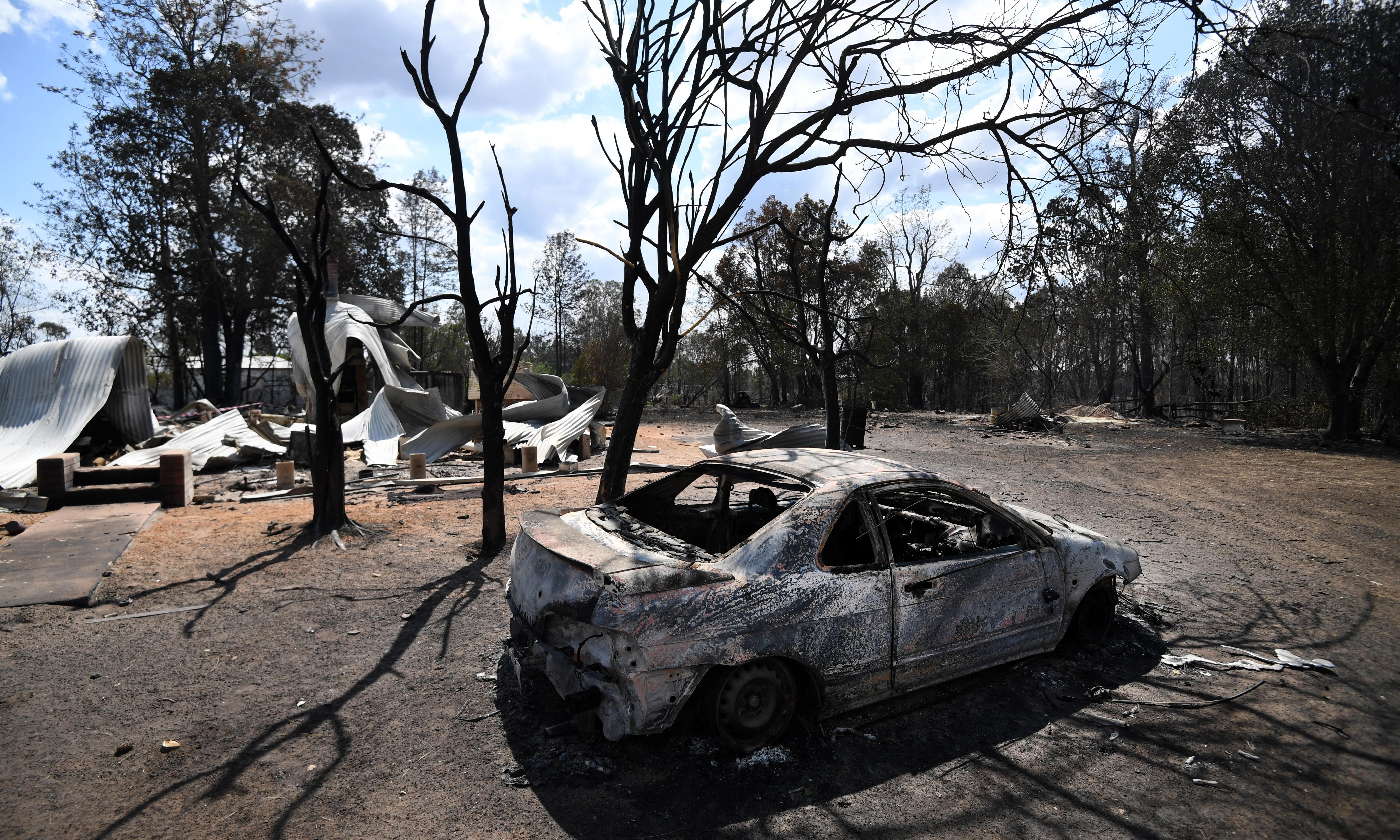 More than 50 homes destroyed by NSW bushfires as rain offers hope of respite