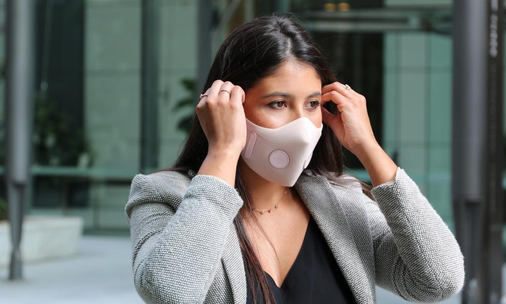 A model wears an anti-pollution face mask prototype from Aus Air.