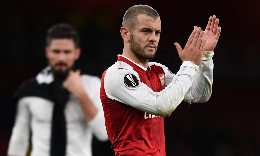 Arsenal's Jack Wilshere applauds fans after the final whistle.