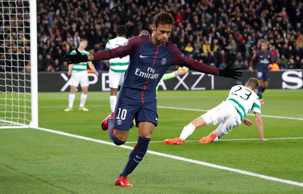 Neymar celebrates scoring their first goal.