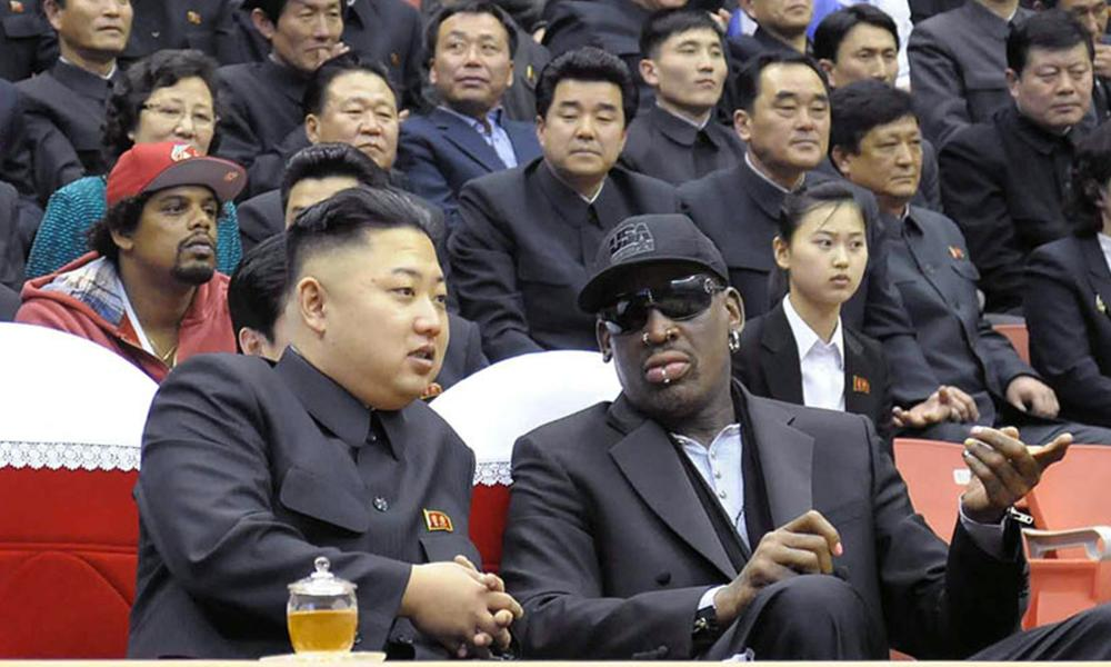 The North Korean leader, Kim Jong-un, left, chats to his friend Dennis Rodman, the former NBA star, at a basketball game in Pyongyang.