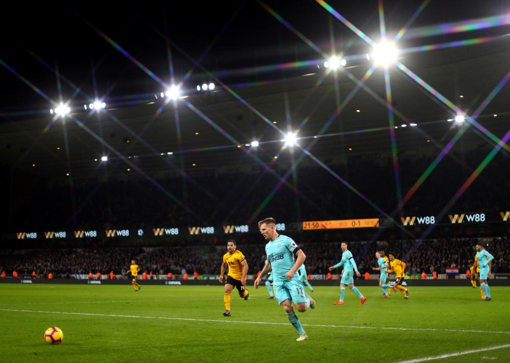 Matt Ritchie in action under the Molineux lights.