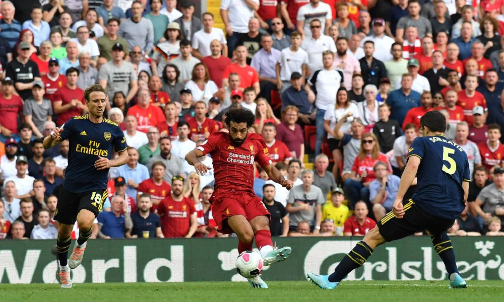 Salah slots the ball in for his second.