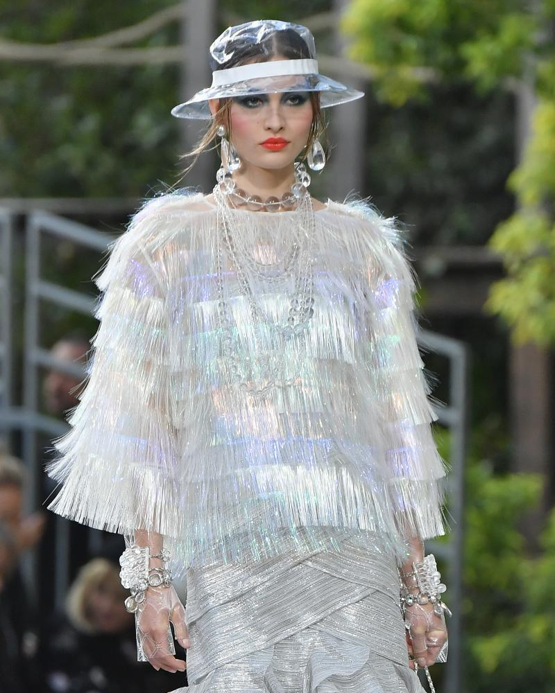 A model walks the runway during the Chanel show