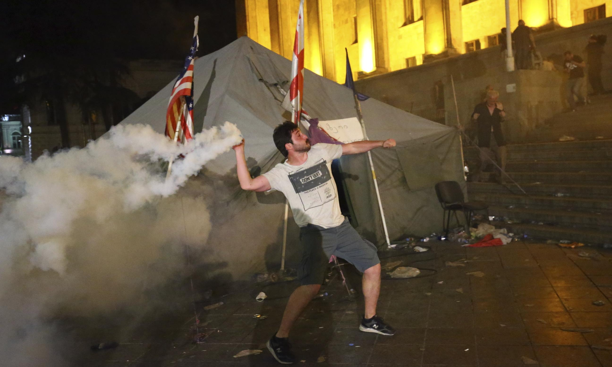 Georgian police fire teargas as Russian's visit to parliament sparks protests