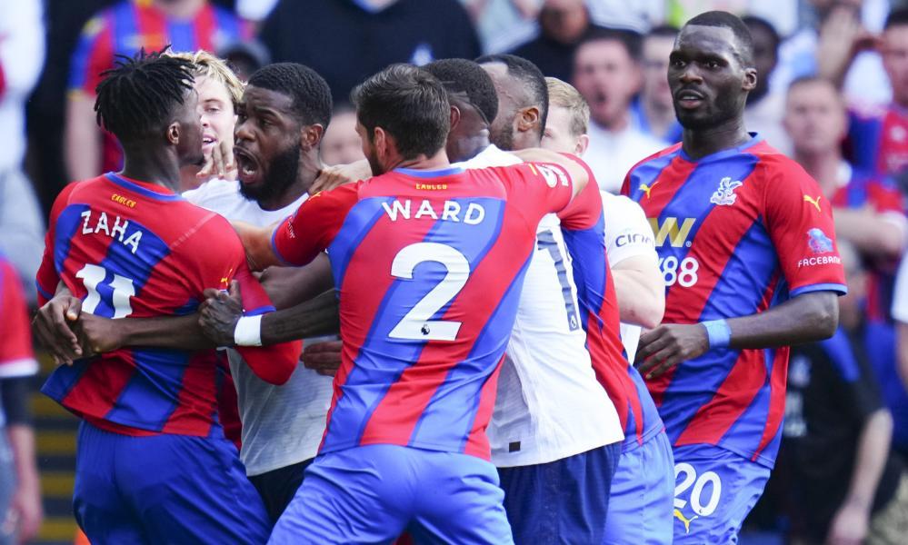Japhet Tanganga of Tottenham Hotspur argues with Wilfried Zaha of Crystal Palace.