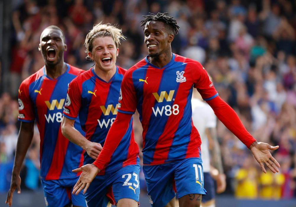 Crystal Palace's Wilfried Zaha celebrates scoring their first goal with Conor Gallagher (centre) and Christian Benteke.