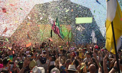 Revellers cheer as Australian singer Kylie performs at the Glastonbury Festival of Music and Performing Arts on Worthy Farm near the village of Pilton in Somerset, South West England, on June 30, 2019. (Photo by Oli SCARFF / AFP)OLI SCARFF/AFP/Getty Images