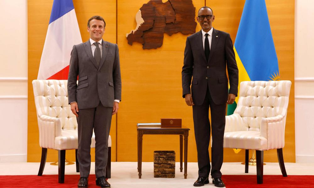Emmanuel Macron (left) and Paul Kagame pose for the photographers at the presidential palace prior to their talks in Kigali.