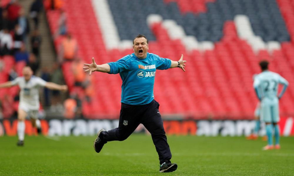 Micky Mellon celebrates Tranmere's promotion to League Two after last May's 2-1 victory over Boreham Wood at Wembley in the National League play-off final.
