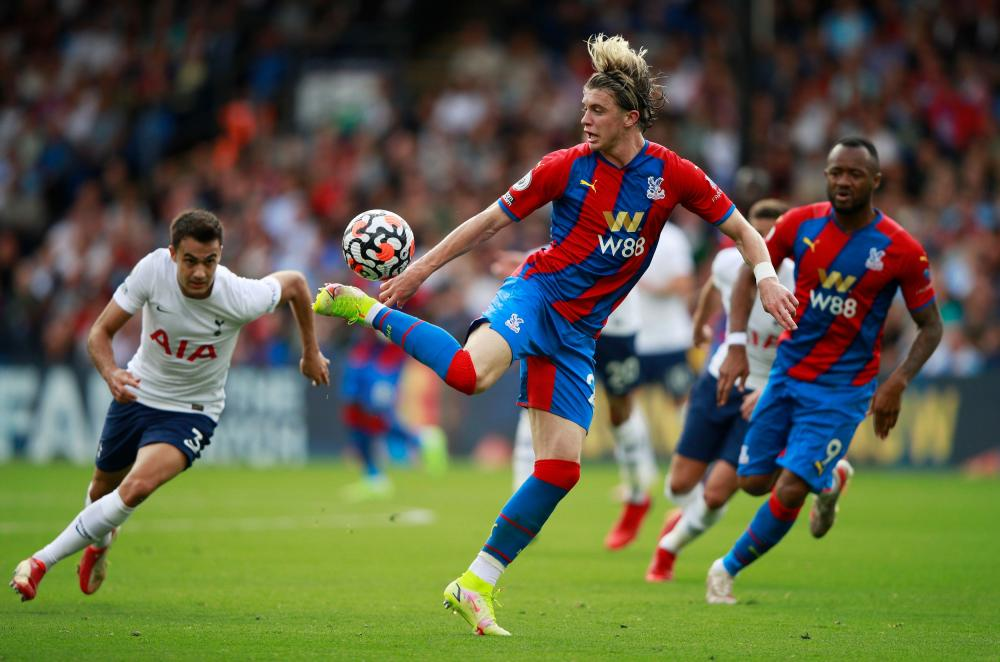 Tottenham Hotspur's Sergio Reguilon (left) gives chase as Crystal Palace's Conor Gallagher controls the ball.