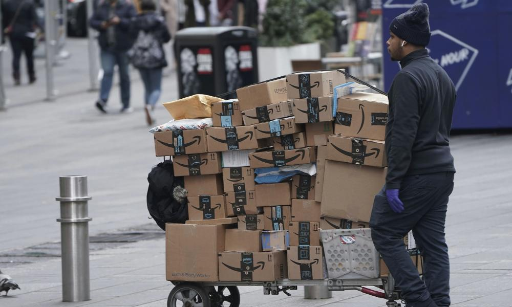 An Amazon delivery person walks in Times Square following the coronavirus outbreak in New York City.