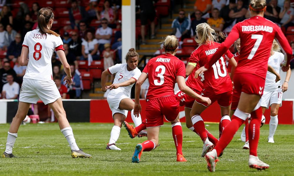 England's Nikita Parris scores their first goal